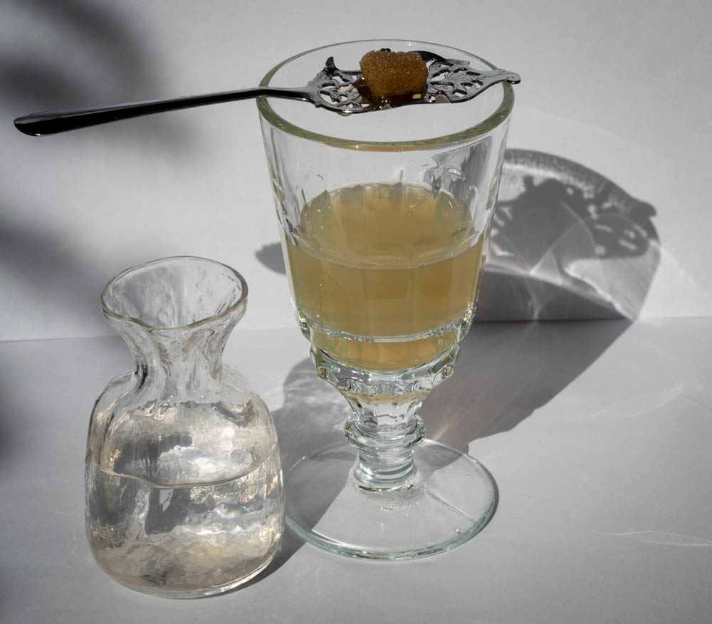 Sweetening absinthe with sugar.